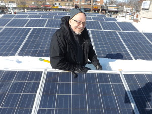 Etobicoke wedding card invitation store owner Jim McNeil show the 52 solar panels on the roof of his store that he says generates about $800 monthly in electricity that goes into the grid.