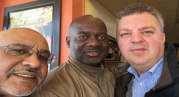 Former Olympic sprinter Ben Johnson with Reporter Tom Godfrey and George Christopolous, former Executive Assistant for Mayor Rob Ford, who are penning an autobiography on the athlete's life that is due out later in 2015.