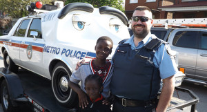 Toronto Police Cruiser with the children and an officer.